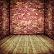 Abstract interior with old brick wall and wooden floor — Foto Stock