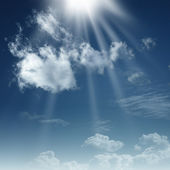 Dramatic skies with white clouds and sun beams — Stock Photo
