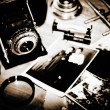 Vintage still life with retro photo camera and old photos — Stock Photo #19773771