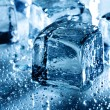 Ice with water droplets over abstract wet background — Stock Photo
