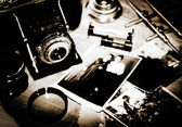 Vintage still life with retro photo camera and old photos — Stock Photo