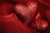 Abstract Valentine's backgrounds over red textile with tho heart — Foto de Stock