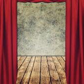 Theatrical grungy backgrounds with red curtains — Stock Photo