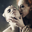 Vampire's kiss. Fantasy female portrait against dark grungy back — Stok fotoğraf