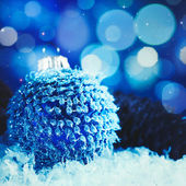 Christmas background with bauble and beauty bokeh — Stock Photo