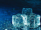 Iced water against abstract blue backgrounds for your design — Stock Photo