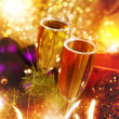 Christmas backgrounds with champagne and garland — Stock Photo
