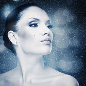 Winter freshness, abstract female portrait with falling snow — Stock Photo