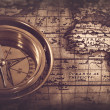 Old compass over the map — Stock Photo