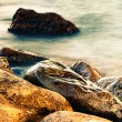 Sleeping sea with coastal rocks — Stok fotoğraf