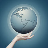 Earth globe into female hand — Stock Photo