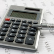 Calculator and pen — Stock Photo #13586720