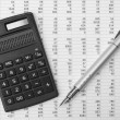 Stock Photo: Calculator and pen