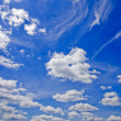 Stock Photo: White clouds over blue sky