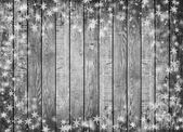 Gray wood wall texture with white snow and stars — Stock Photo