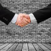 Businesmen handshake — Stock Photo