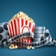 Movie film reel and popcorn — Imagen vectorial
