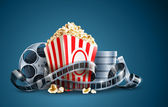 Movie film reel and popcorn — Vector de stock