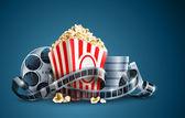 Palomitas de maíz y carrete de película de cine — Vector de stock