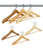 Wooden coat hangers on the tube for wardrobe clothes — Stock Vector