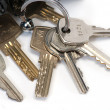 Bunch of keys isolated over white — Stock Photo