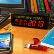 "Clock with ""Happy New Year!"" message on table — Stok fotoğraf"