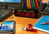 """Clock with """"Happy New Year!"""" message on table — Stock Photo"""