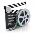 Clapper board and reel with filmstrip — Stock Photo