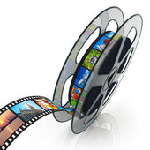 Film reel with filmstrip — 图库照片