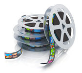 Film reels with filmstrips — Stock Photo