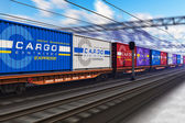 Freight train with cargo containers — Стоковое фото