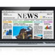 Royalty-Free Stock Photo: Laptop with business news site on screen