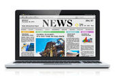 Laptop with business news site on screen — Stock Photo