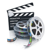Clapper board and reels with filmstrips — Stockfoto