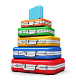 Stack of color travel cases — Stock Photo