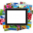 Blank tablet computer on heap of colorful photos — Zdjęcie stockowe