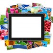 Blank tablet computer on heap of colorful photos — Stok fotoğraf