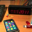 "Clock with ""Happy New Year! 2012"" message on table — Stock Video"