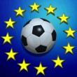 Vídeo Stock: Rotating soccer ball on European Union flag
