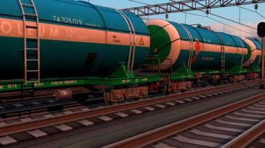 Freight train with petroleum tank cars passing by the railway station on sunset — Stock Video