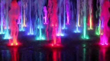Beautiful colorful fountain at night — Stock Video