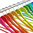 Rainbow coat hangers on clothes rail - Foto de Stock