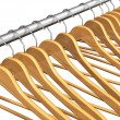 Royalty-Free Stock Photo: Wooden coat hangers on clothes rail