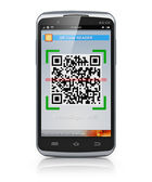 Smartphone scanning QR code — Stock Photo