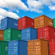 Stock Photo: Stacked cargo containers in port
