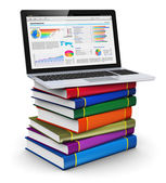 Laptop on stack of color books — Stok fotoğraf