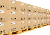 Stacked cardbaord boxes on shipping pallets — Stock Photo