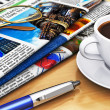 Newspapers and coffee on office table - Stock Photo