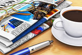 Newspapers and coffee on office table — Stock Photo