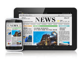 Tablet PC and smartphone with business news — Stock Photo